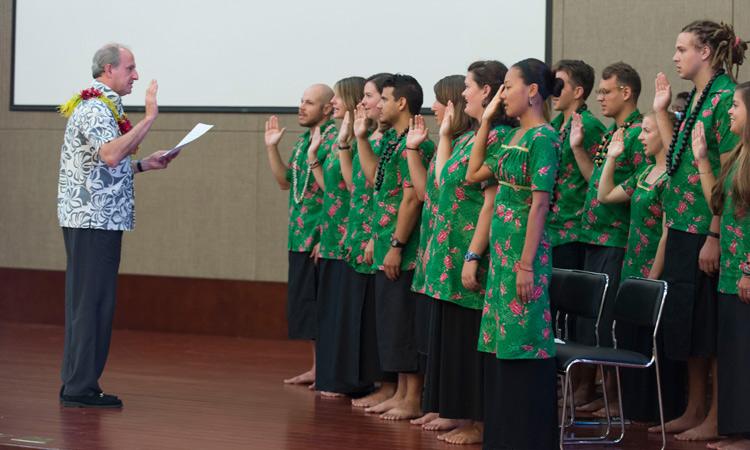 U.S. Ambassador Gilbert swearing in the Peace Corp Volunteers. Photo credit: U.S. Department of State.
