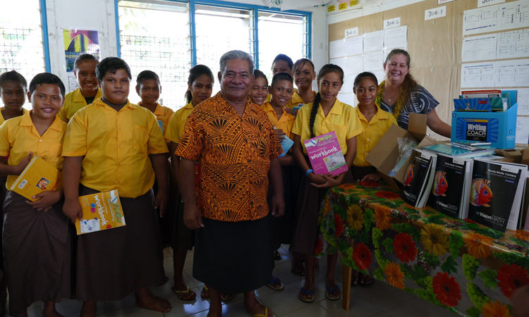 School Principal Aumua Simanu and Chargé d'Affaires Angelina Wilkinson with the Year 8 students of Aele Primary school after the presentation of the book donation. Photo credit: U.S. Department of State.